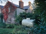 Inlndische Propan Gas Tank Im Garten Des Country House Uk Stockfoto for dimensions 1300 X 1147